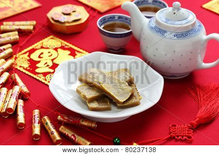 nian gao, chinese new year rice cake, pan fried and dipped in egg
