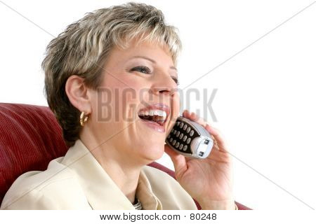 Beautiful Woman Speaking On A Cordless House Phone Over White
