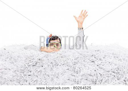 Man diving in a pile of shredded paper isolated on white background