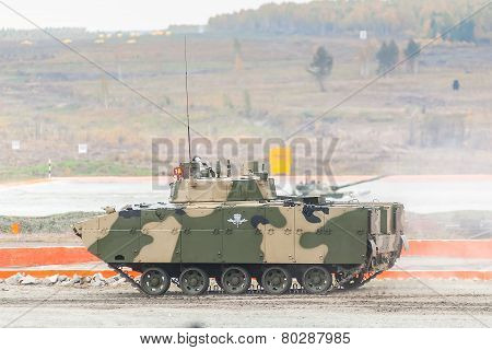 Nizhniy Tagil, Russia - September 25. 2013: Airborne tracked armoured personnel carrier BMD-4M with additional protection on demonstration range. Russia Arms Expo-2013 exhibition poster
