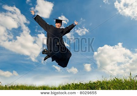 Happy Jumping Graduate Outdoors