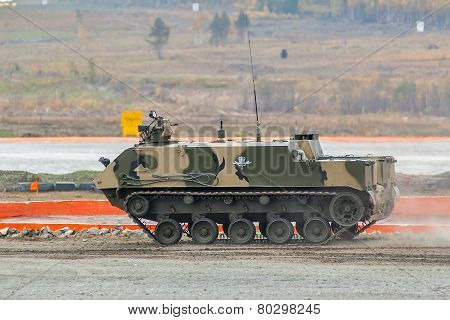 Nizhniy Tagil, Russia - September 25. 2013: Airborne tracked armoured personnel carrier BTR-MDM Rakushka-M on demonstration range. Russia Arms Expo-2013 exhibition poster