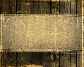 Burlap jute canvas banner textured with dark wood background. Great banners for textures and backgrounds poster