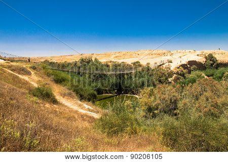 Suspension bridge and Besor Brook in Eshkol National Park Negev desert. Israel poster