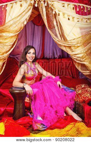 Oriental Beauty Sitting In A Tent