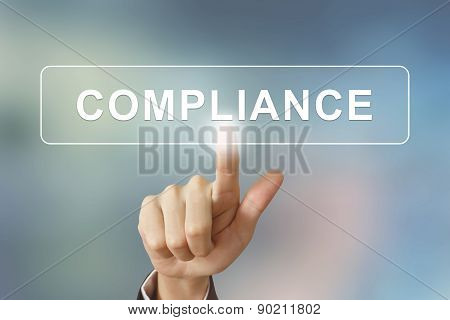Business Hand Clicking Compliance Button On Blurred Background