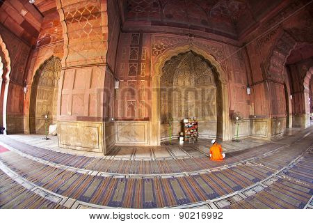 NEW DELHI, INDIA - JUNE 4, 2012: man praying in the Jama Masjid Mosque in Delhi