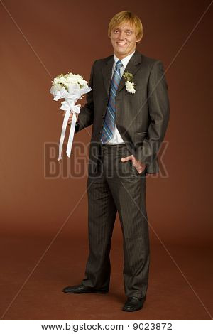 Happy Groom With Bouquet
