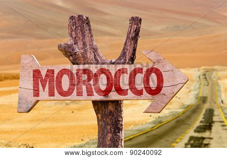 Morocco wooden sign with desert background