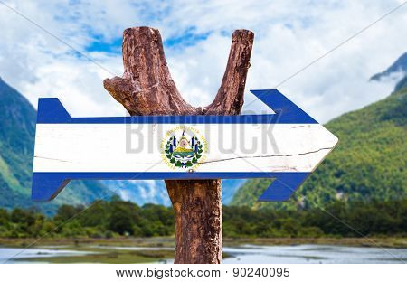 El Salvador Flag wooden sign with mountains background