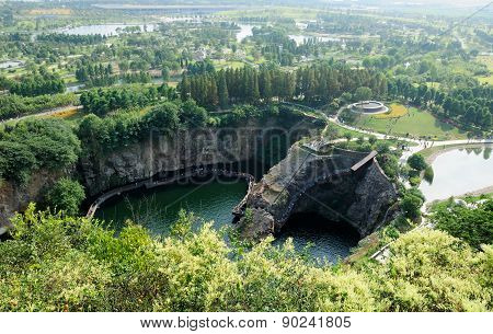 The old quarry at Chenshan Botanical Garden from a top Chenshan Hill in Songjiang district in Shanghai China. poster