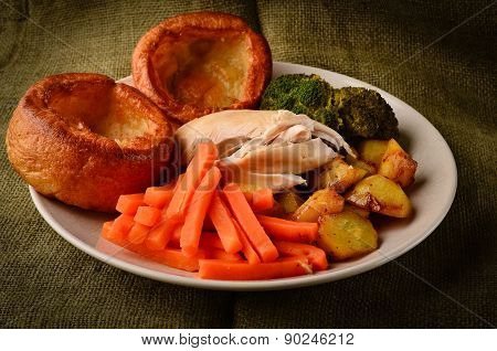 Chicken Sunday Dinner With Yorkshire Puddings on a rustic hessian background poster