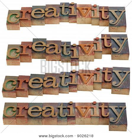 creativity - word in vintage wooden letterpress printing blocks isolated on white four layouts poster