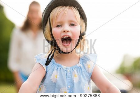 Blonde, Blue-eyed, Smiling And Happy Girl Wearing A Bike Helmet