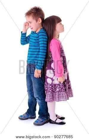 Little Aggrieved Boy Standing Near Girlfriend
