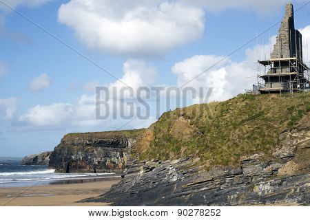 Castle Surrounded By Scafolding On Cliffs