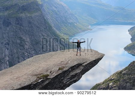 Young girl on the Troll's tongue (norw. Trolltunga).