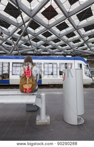 Girl Waits For Tram On The Hague Central Station