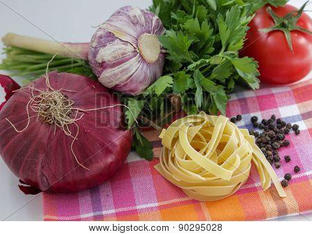 Vegetables for coocking pasta: garlic, onion, tomato, parley
