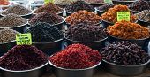 A group of various dried fruits at Turkish Bazaar, sign says  new yield blueberries and apricots from Malatya, the Turkish city which is famous for its apricots. poster