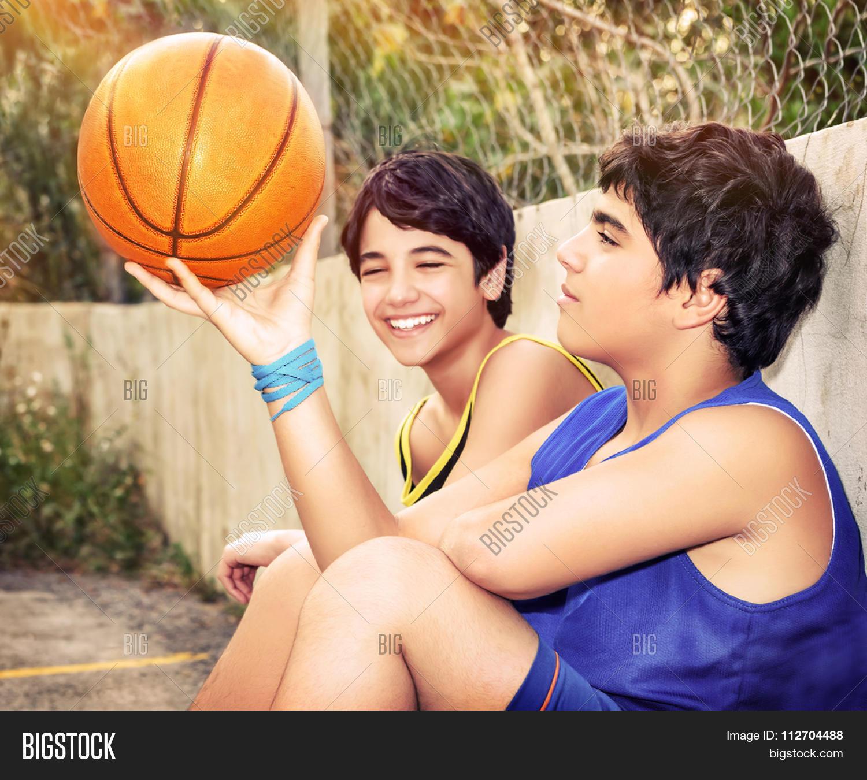 cute basketball players sitting image photo bigstock. Black Bedroom Furniture Sets. Home Design Ideas