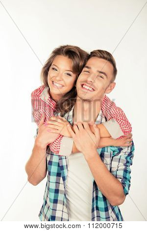 Cheerful Pretty Young Woman Embracing Her Boyfriend