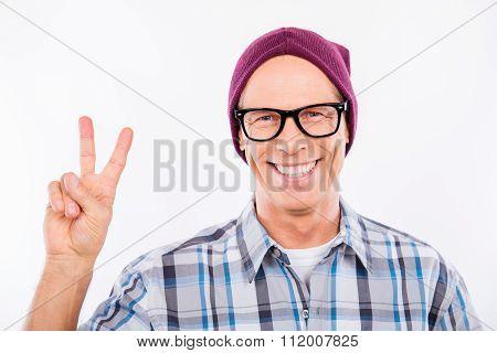 Cute Senior Man In Glasses Showing