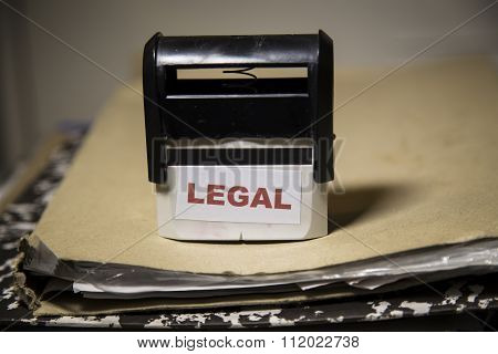 Legal Stamp On A Big Folder Of Paperwork