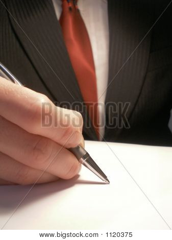 Business Man Signing Or Writing