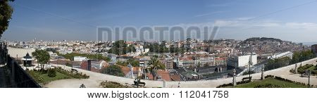 Lisbon, Portugal - September 2015: Panoramic view over the city of Lisbon, Portugal, in September 2015, from Bairro Alto, with some people walking through the park
