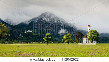 Church Of St. Coloman In Schwangau And Neuschwanstein Castle.