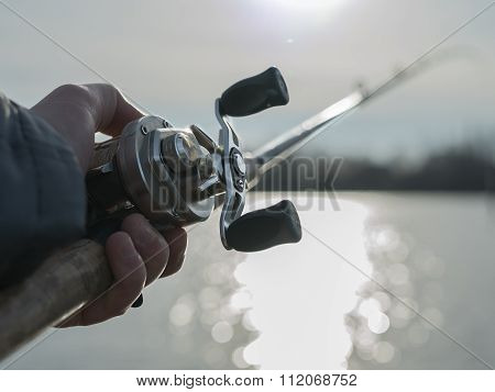 Angler with baitcasting reel in hilights
