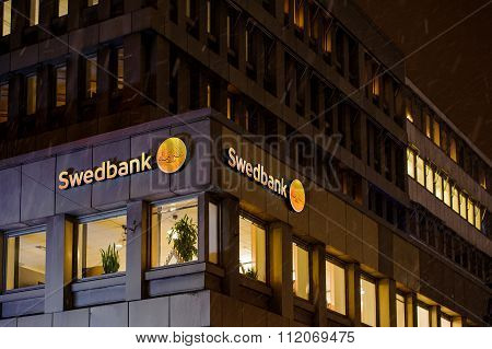 Swedbank Logo On A Snowy Night On The Building Facade