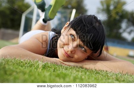 closeup of beautiful dreamy woman face that lies on grass poster