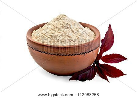 Flour amaranth in clay bowl with purple flower