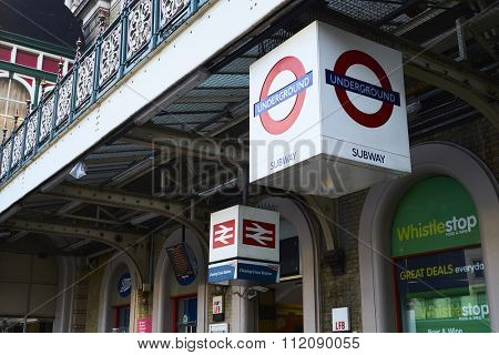 LONDON, UK - DECEMBER 19: Entrance to Charing Cross station with signs depicting London Underground and rail logos. December 19, 2015 in London.