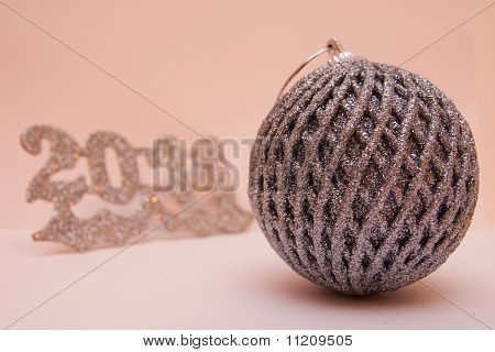 New year with a Christmas ball in silver