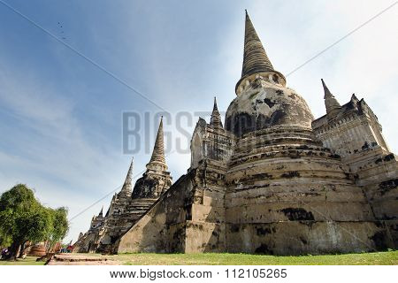 Old Pagoda With Cloudy Sky In Thailand