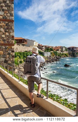 Photographer With Backpack Shooting In Old Town Sozopol Near Sea In Summer