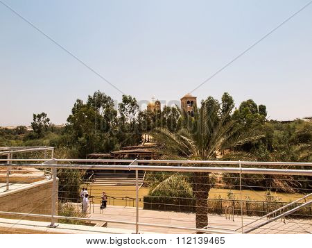 YERICHO ISRAEL - JULY 14 2014: Pilgrims in Qasr el Yahud. According to tradition it's the place where the Israelites crossed the Jordan River and where the baptism of Jesus took place. Israel
