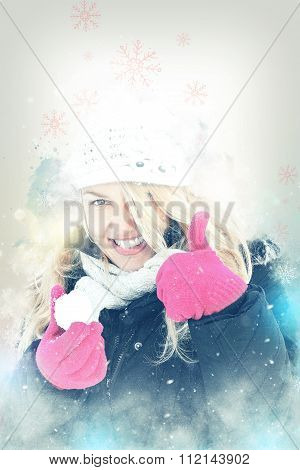 Happy Woman In Snow Holding Snow Ball In Hand For Snowballing