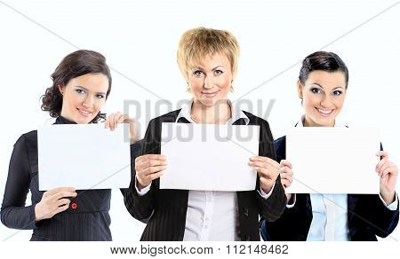 a group of business women with placards in hands