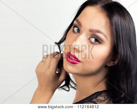 Portrait Of A Young Woman Over White Background