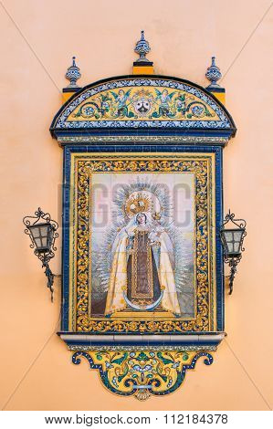 The tiled icon on wall of oldest city Church of Santa Ana, loca