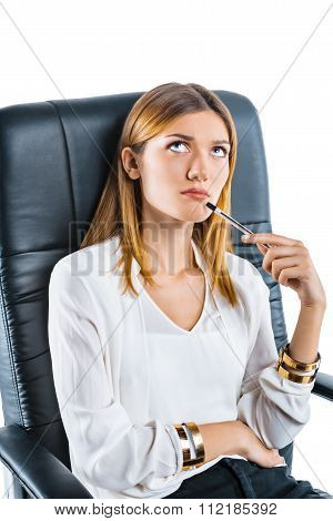 Portrait of young businesswoman in bossy chair. Businesswoman on white background thoughtfully looking up