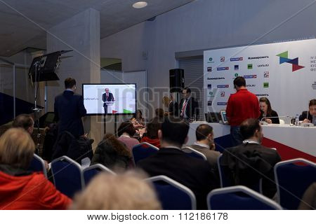 ST. PETERSBURG, RUSSIA - DECEMBER 14, 2015: Journalists work during the speech of President of Russia Vladimir Putin on the plenary meeting during 4th St. Petersburg International Cultural Forum