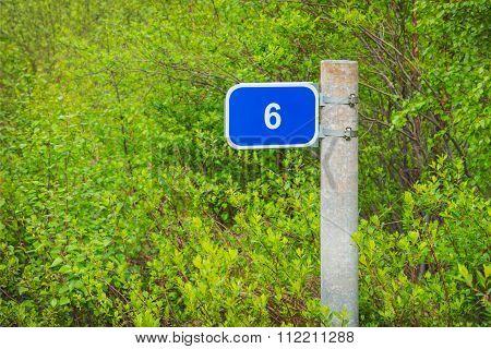 Milepost mileage kilometrs on the roadside