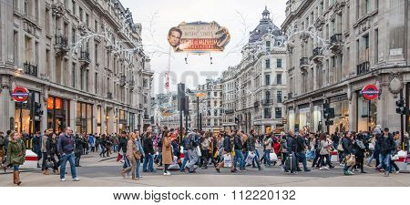 LONDON, UK - NOVEMBER 30, 2014: Regent street, Oxford circus with lots of pedestrians and cars, taxi
