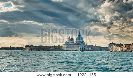 Venice cityscape from the Giudecca Canal with the Basilica Santa Maria della Salute, Punta della Dogona and Dorsoduro zattere in Venice, Italy