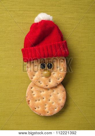 Happy Christmas Hardtack In Santa Hat On Yellow Background